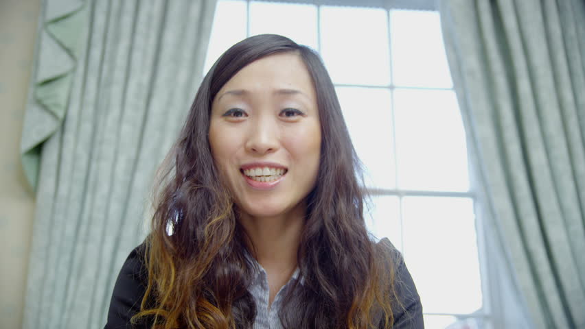 Happy Young Asian Businesswoman Is Video Chatting, As Seen -2384