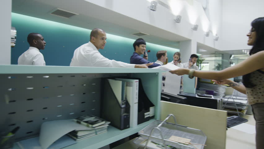 Attractive young multi ethnic group working together as a team in a busy modern office or call center. In slow motion. | Shutterstock HD Video #4388117