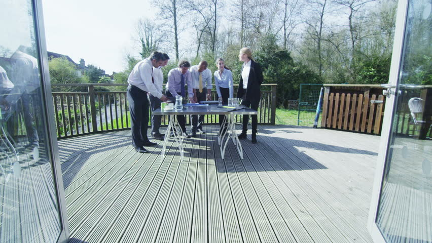 sunny day home office. Business Group Come Together For A Casual Outdoor Meeting On Bright Sunny Day. They Day Home Office