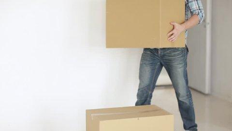 footage of man moving big cardboard boxes