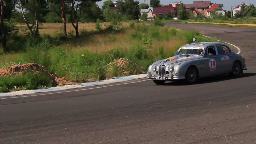 KIEV, UKRAINE - JUNE 22: International Rally Peking to Paris 2013. Vintage silver Jaguar MkII with additional light on the roof | Shutterstock HD Video #4401077