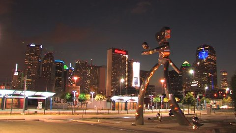 Dallas rail station at night with public art sculpture