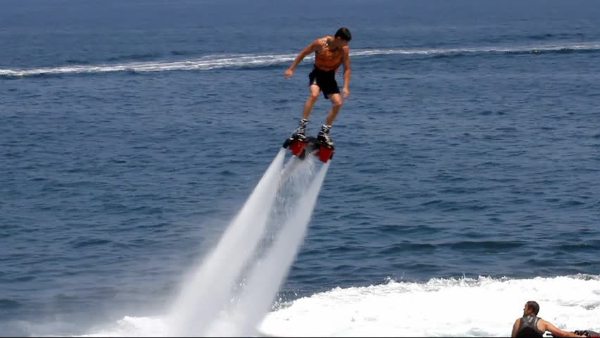 """ALICANTE, SPAIN – AUGUST 04: The """"Flyboard"""" is a new sport for lovers of water sports. His spectacular amazes all swimmers.; Spain; on august 04, 2013 in Alicante."""