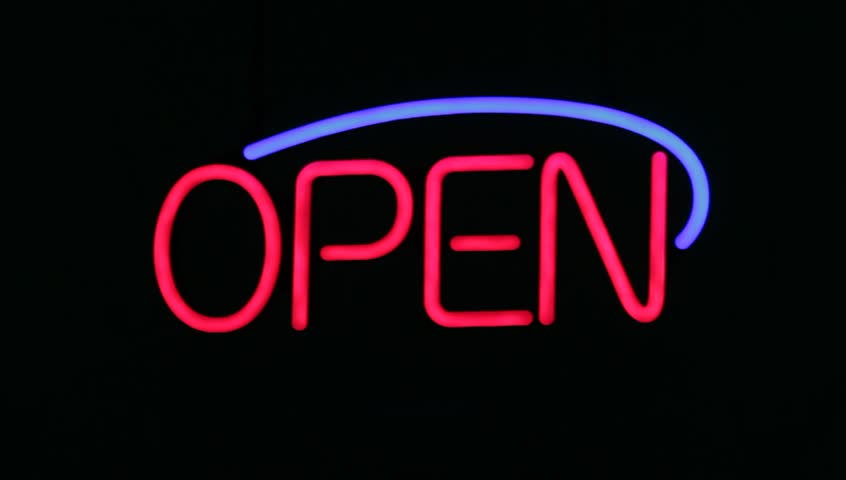 OPEN sign with a black background, the sign flashes and blinks.