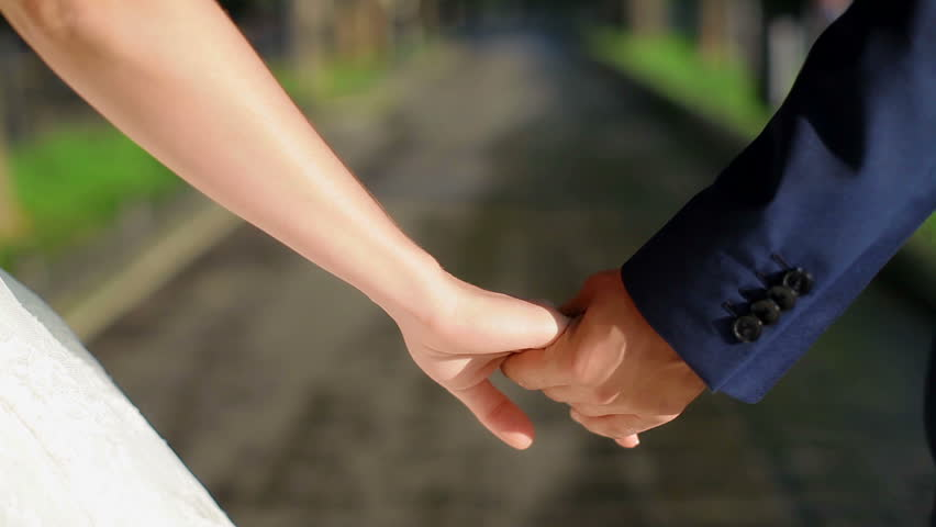 Newly married couple walk together holding hands | Shutterstock HD Video #4426694