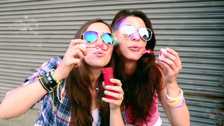 Young women blowing bubbles in slow motion  | Shutterstock HD Video #4435727