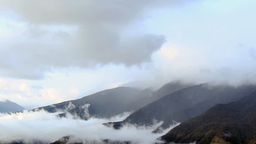 Clouds and mist blowing over mountain tops in the Pastaza Valley near the tourist town of Banos in the Ecuadorian Andes | Shutterstock HD Video #4447367