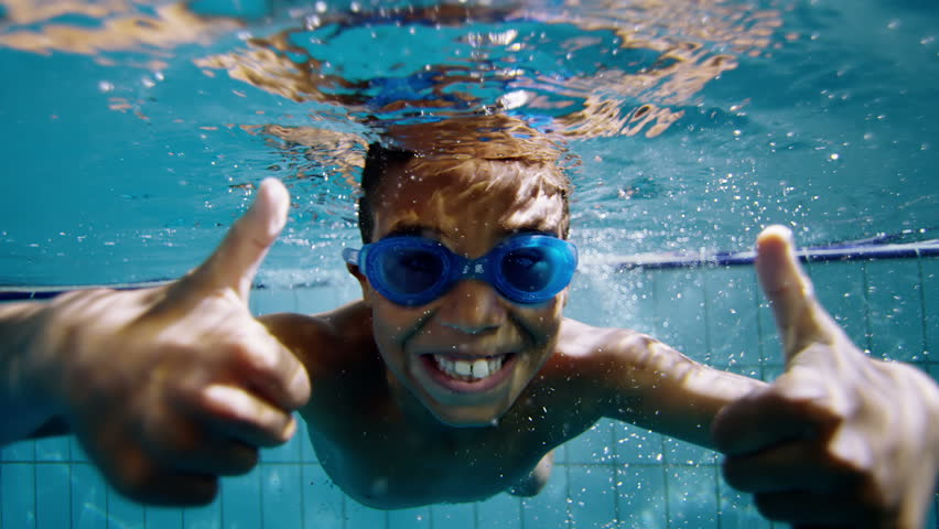 Happy cute little boy underwater gives a thumbs up to the camera. | Shutterstock HD Video #4459331