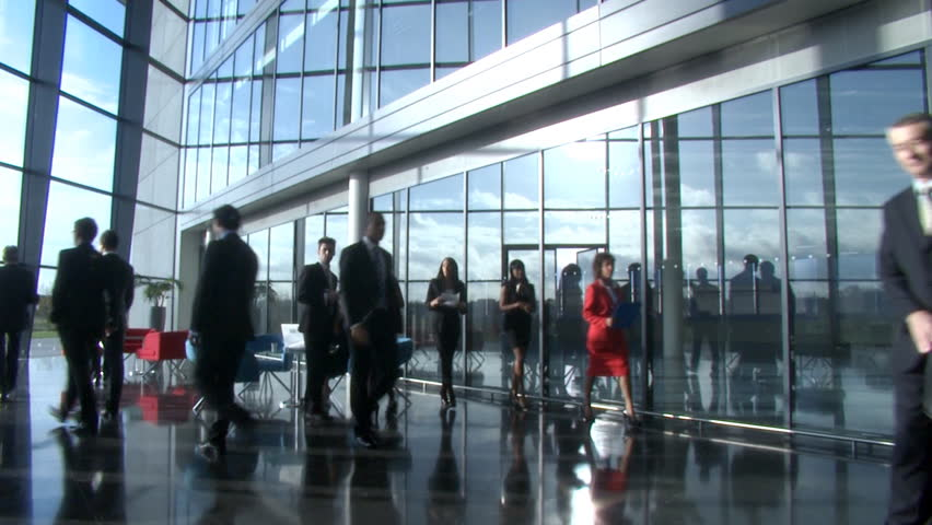 Business partners meet and shake hands in large contemporary corporate building. High quality HD video footage
