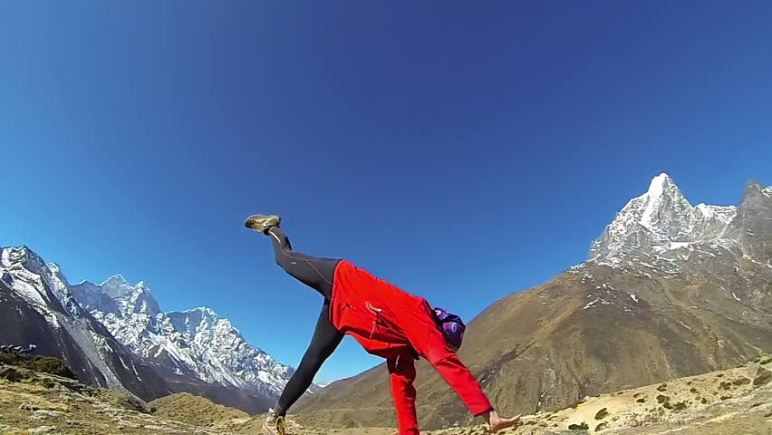 Happy woman doing the cartwheel on the top of the world, Mount Everest,Himalayas .Slow motion,high speed camera | Shutterstock HD Video #4486985