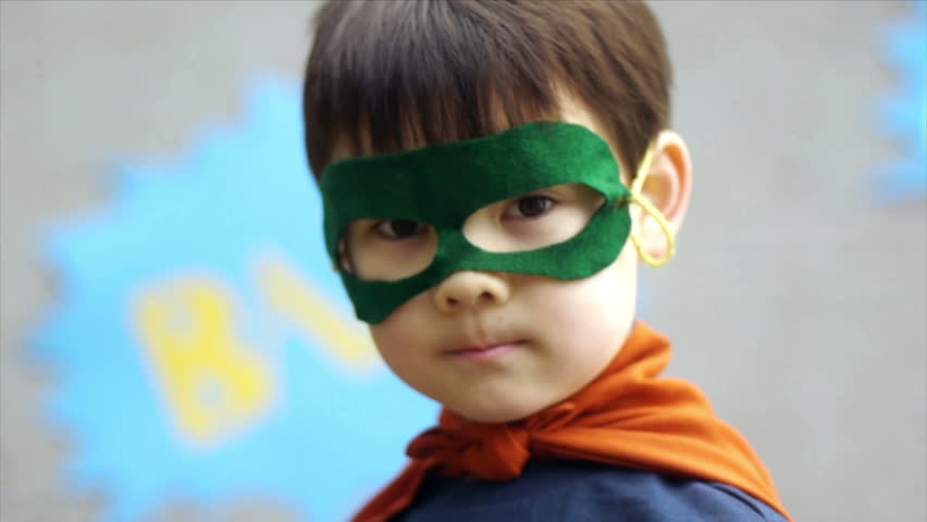 Superhero boy smiles and flaps his arms, pretending to fly. | Shutterstock Video #4489517