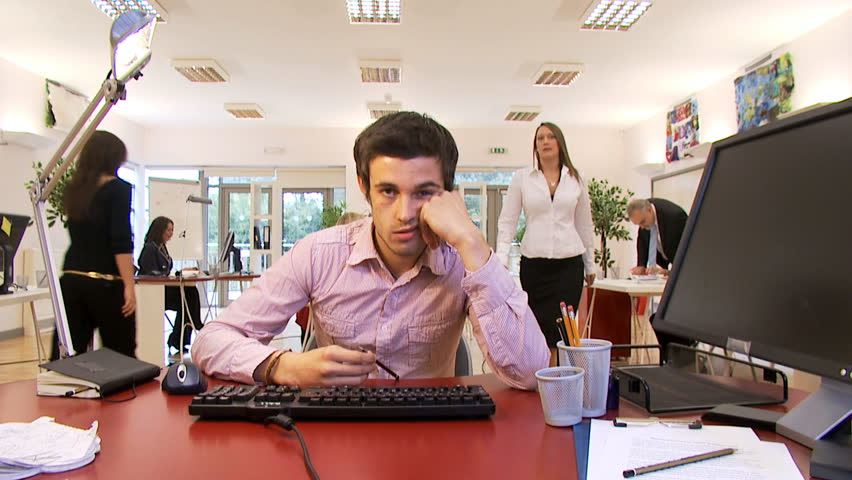 Bored male office worker struggles to stay awake at his desk. | Shutterstock HD Video #4493948