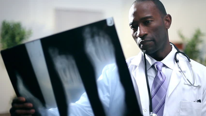Hospital medical staff examine a patient's xray.   Shutterstock HD Video #4494677