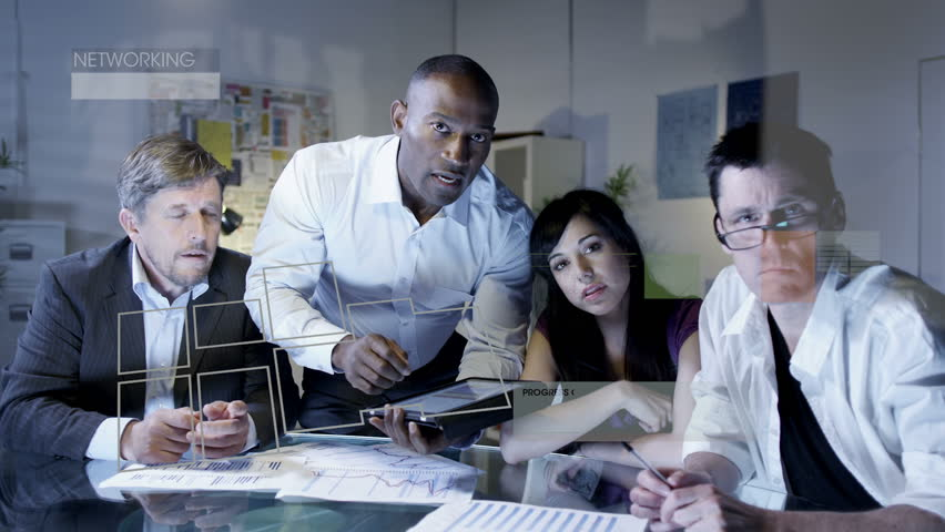 Business team working on futuristic touch screen with tablet remote interface. | Shutterstock HD Video #4496918