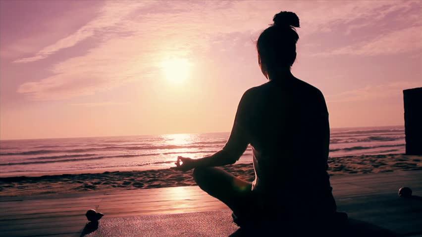 Meditation near the sea & doing yoga on a beach at sunrise | Shutterstock HD Video #4499921