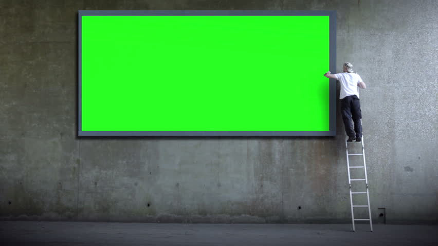 green screen wall for copy space advertising man erects billboard