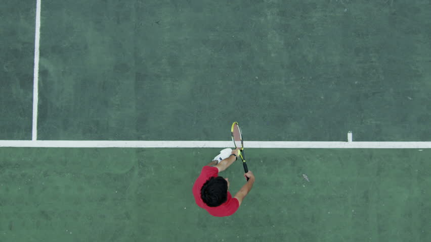 Tennis serve in slow motion from overhead angle. Shot on RED Epic at 240 fps