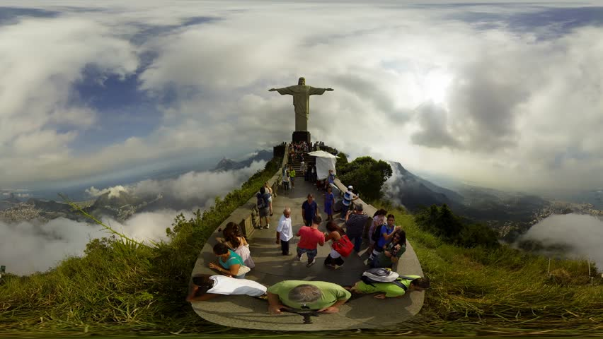 RIO DE JANEIRO, BRAZIL – JUNE 27: Tourists and world travelers visit the statue of Christ the Redeemer on top of Corcovado mountain,360 video panorama, time lapse,  Brazil, June 27, 2013.