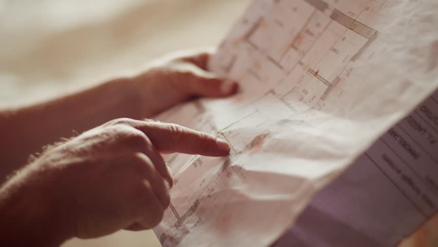 Construction worker and building plans, architect or engineer looking and examining blueprints of new houses and apartments. Part 7 of 11