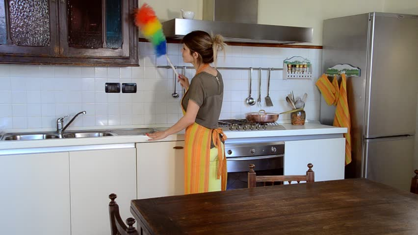 Young Woman Cleaning The Furniture In The Kitchen   HD Stock Footage Clip