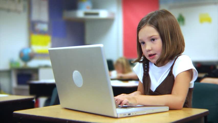 School student working on laptop computer | Shutterstock HD Video #4542887