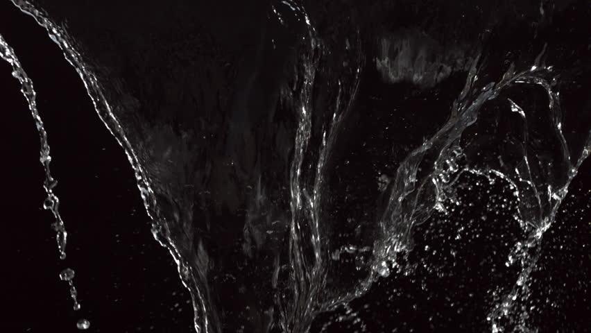 Water splash on black background, slow motion