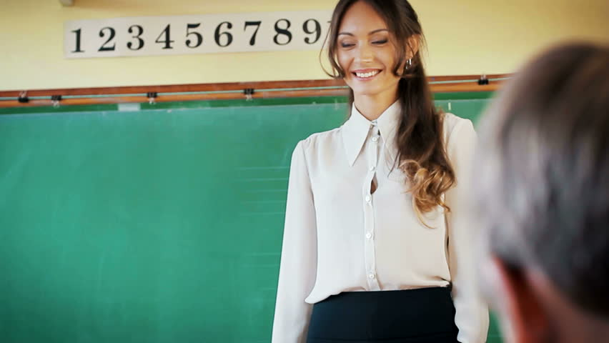 Young Attractive Female Teacher Of Maths Interacting With -4419