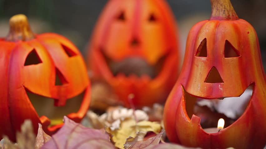Scary halloween pumpkins jack-o-lantern candle lit. Autumn holidays concept | Shutterstock HD Video #4571177