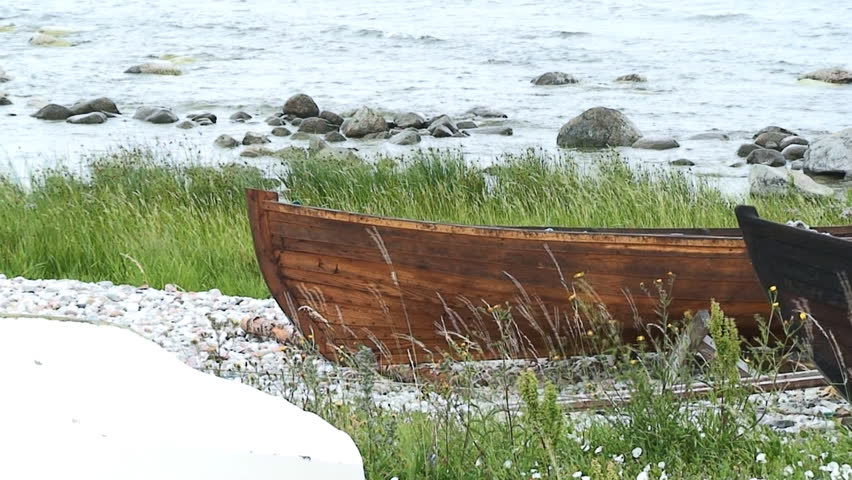 Old boat on a grass beach