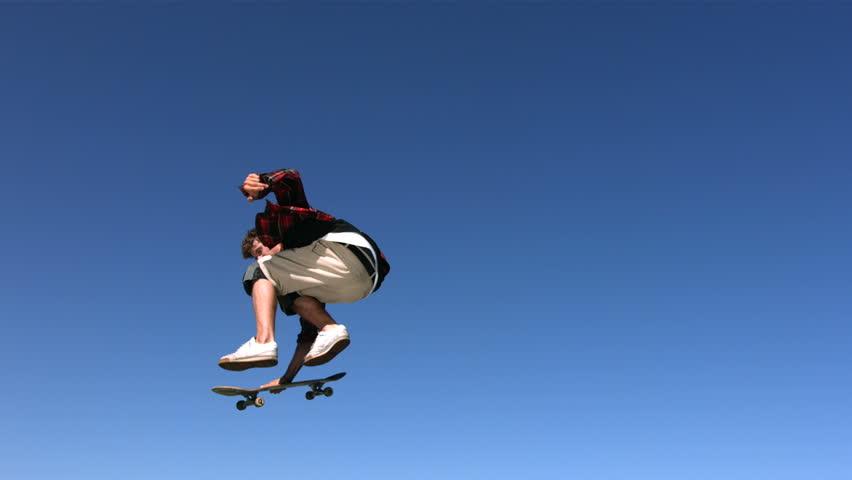 Skateboarder flying in air, slow motion #4578287