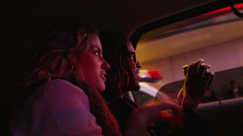 Young couple riding in taxi cab, New York City