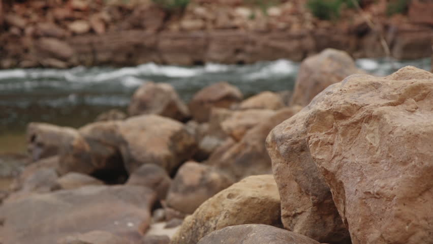 Rack focus from the rocks to the Colorado river in the Grand Canyon.