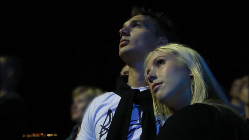 Young couple looking at fireworks