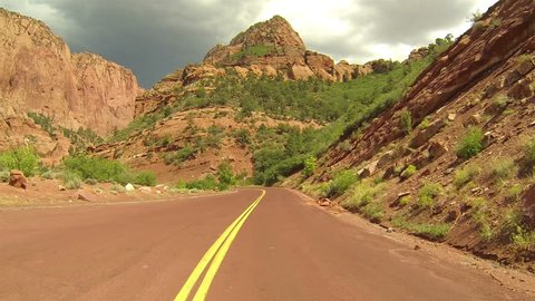 Beautiful Kolob Canyon red mountain drive fast timelapse Point Of View. Kolob Canyon of the Colorado Plateau, Great Basin and Mojave Desert southwest Utah. Incredible red Navajo Sandstone mountains.