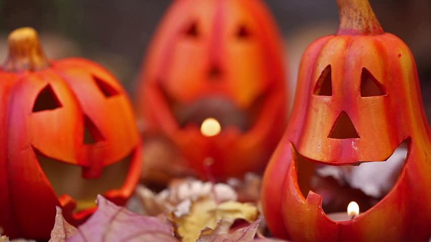 Scary halloween pumpkins jack-o-lantern candle lit. Autumn holidays concept | Shutterstock HD Video #4603367