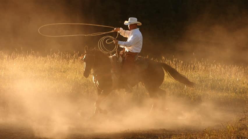 Cowboy roping at sunset, slow motion #4617497