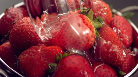 Rinsing strawberries in colander