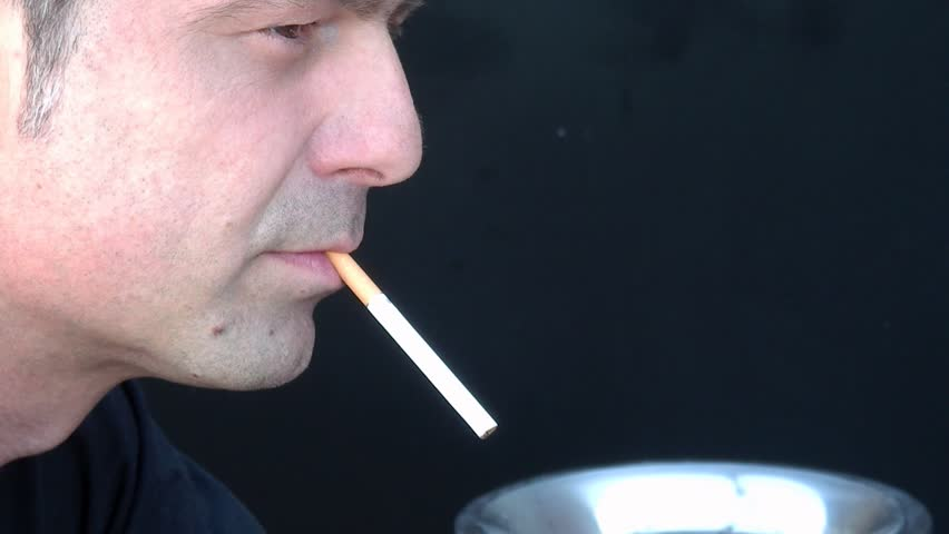 A man lighting a cigarette... followed by a closer cadre of his mouth  sc 1 st  Shutterstock & Man Lighting Up Cigarette With Match In Slow Motion Stock Footage ... azcodes.com