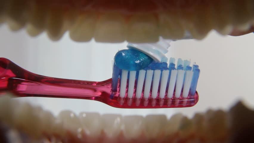Brushing teeth, mouth POV