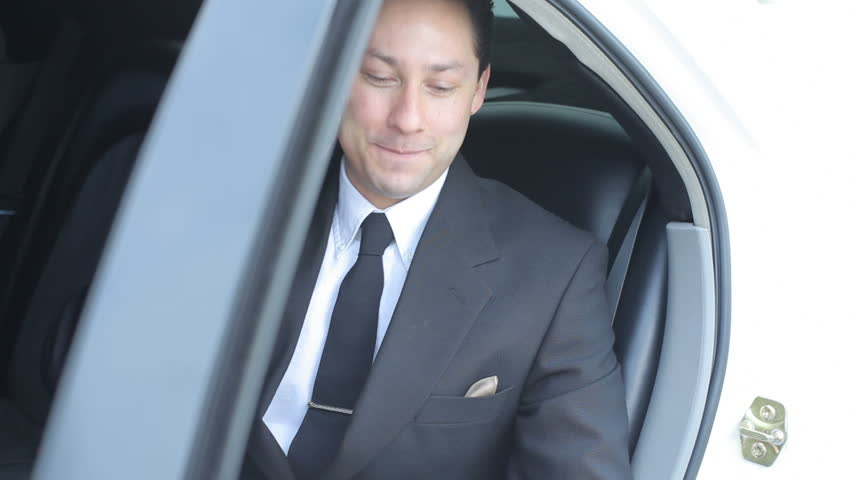Businessman gets out of limo  | Shutterstock HD Video #4643927