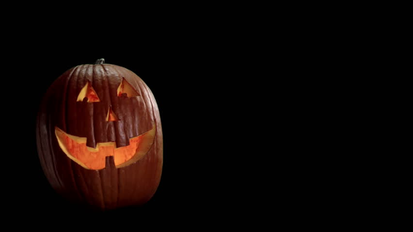 carved halloween pumpkin on a black background with room for images hd stock video - Halloween Background Video