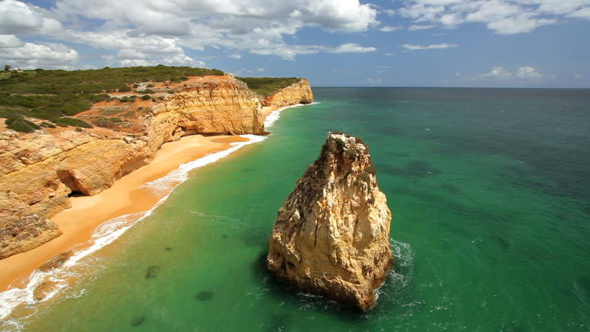 Aerial view of a large rocky outcropping off the shore ofPraia Dos Caneiros, Ferragudo, Algarve, Portugal