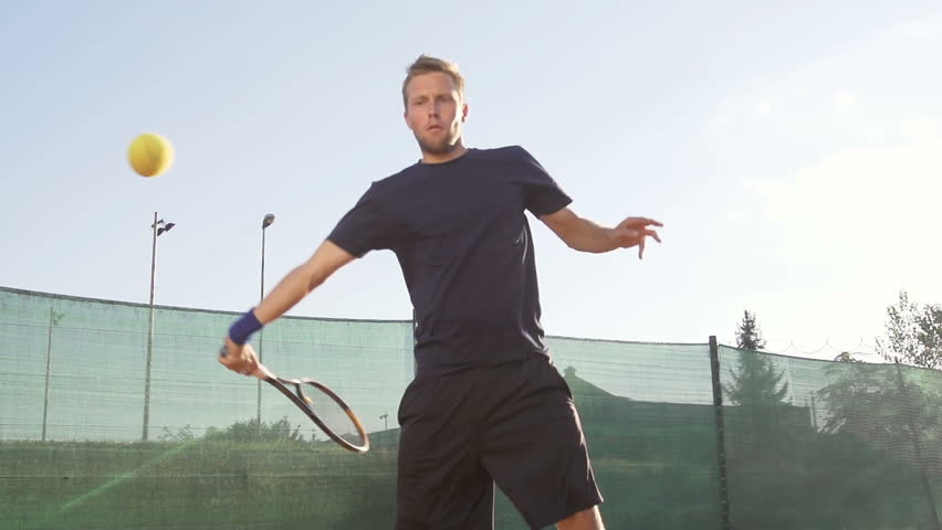 Slow Motion Shot Of A Professional Tennis Player Hitting Forehand With Tennis
