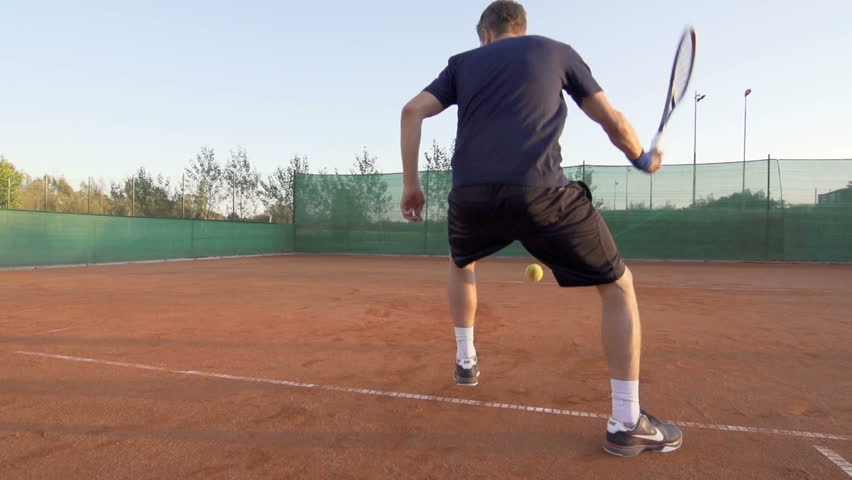 Slow Motion Shot Of A Professional Tennis Player Hitting The Ball From In