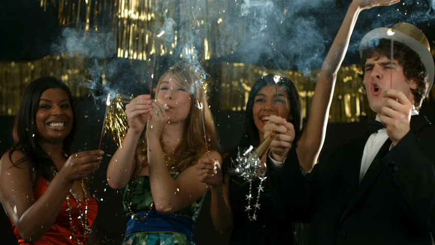 Group of people at New Year's party with sparklers