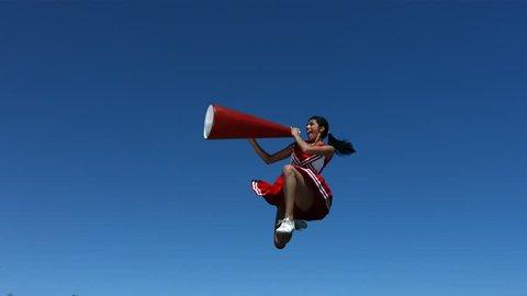 Cheerleader with megaphone, slow motion