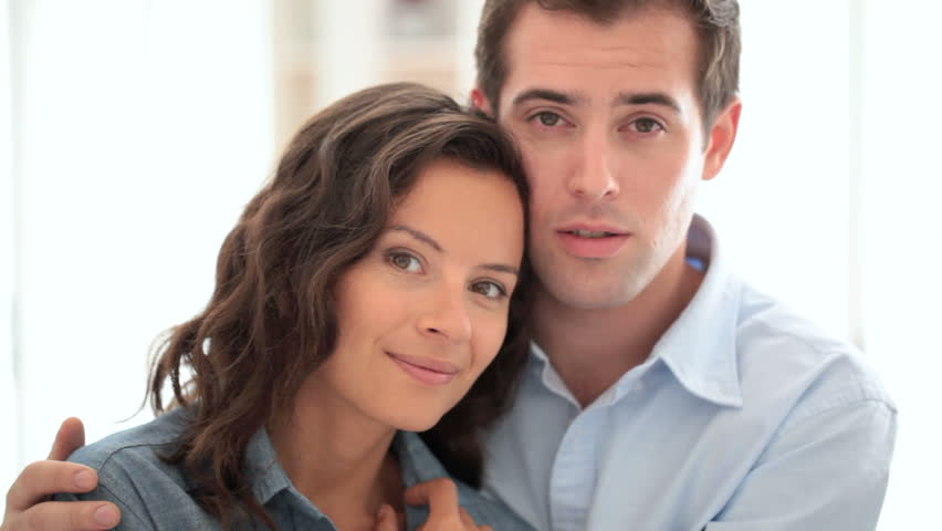 Portrait of smiling loving couple, indoor, looking camera