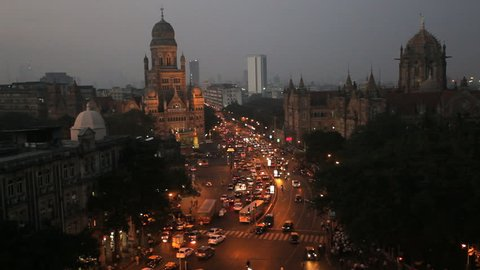 Nighttime aerial view of pedestrian and automobile traffic over central Mumbai Heritage buildings and CST Railway station, Mumbai, India