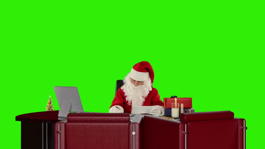 Santa Claus reading letters and sorting presents, Green Screen