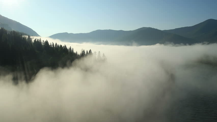 Aerial View. Flying over the high mountains in beautiful clouds . Aerial camera shot.  Air clouds. Altai, Siberia.  #4672181